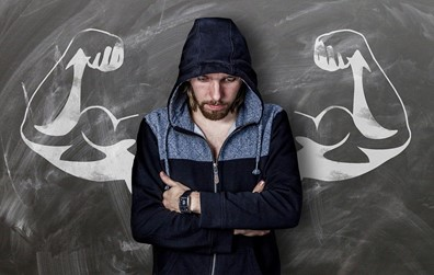 COVID-Resistant Super Humans - Young Man stands in front of Chalk Biceps